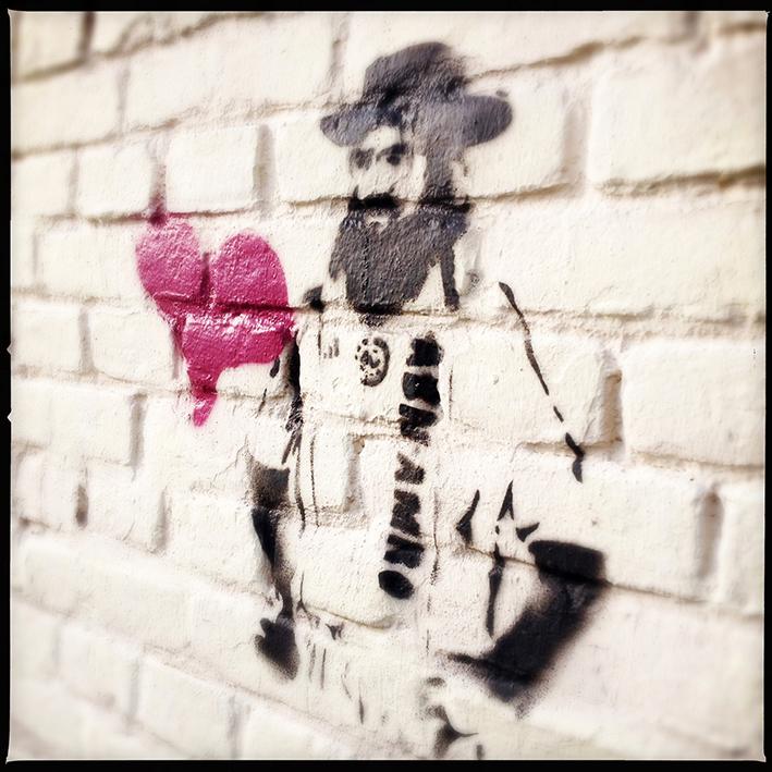graffiti van een Chassidische man ergens aan het Prins Hendrikplein in Den Haag